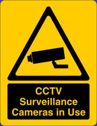 cctv surveillance camera in operation warning signs